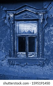 The window in the old farmhouse. The image is tinted in the color of the year-classic blue.