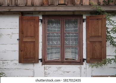 window of the old house with shutters - Shutterstock ID 1817012435