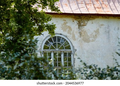 A window of an old medieval protestant church, Estonia. High quality photo. Selective focus