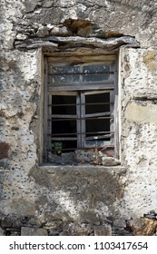 Window of old traditional ruined greek house on the Crete island, Greece