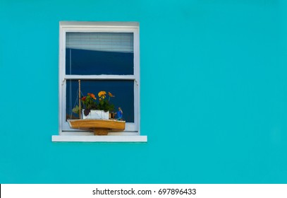 window on a blue wall