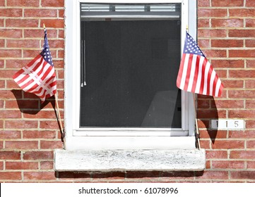 Window on a brick wall with American flags