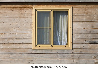 Window on facade wooden structure.