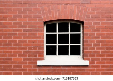 window on old brick wall background