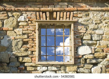 Window on an old building seeing blue sky through it