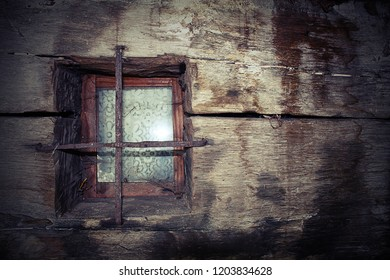 window on old log house, detail of textured wooden wall