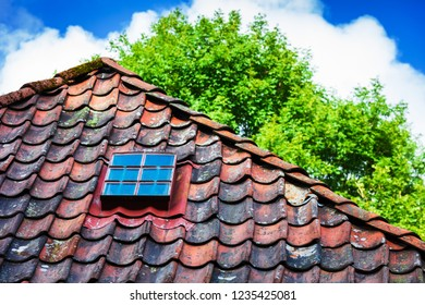 window on the old tile roof