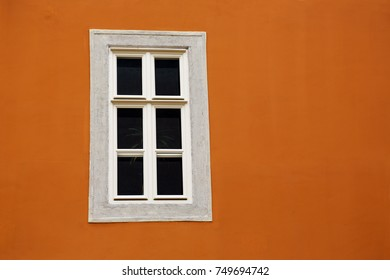 window on the plastered and painted house wall