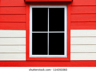 window on red and white wall