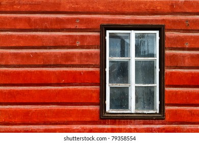 window on the red wooden wall
