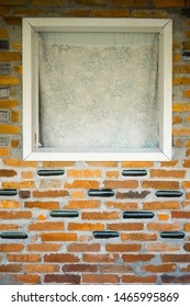 Window on a self-made house wall built with and bricks recycled bottles. Architecture green materials. Homemade construction. Sustainability concept.