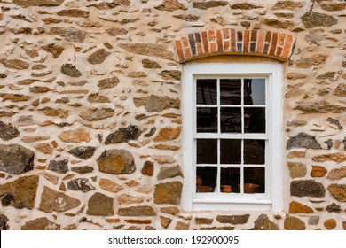 Window on stone wall at Old Salem Museum and Gardens.