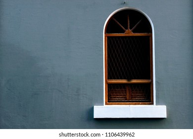 A window on a vacant wall in the streets of french colony, Pondicherry (Puducherry), India