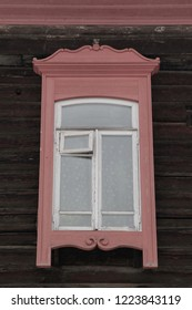 Window on wooden house in Tomsk city (Russia)