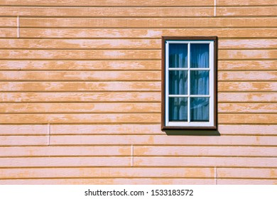 Window on wooden weatherboard wall with copy space