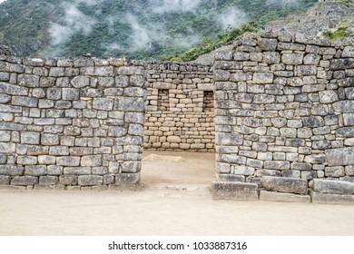 Window openings in the beautiful stone work walls at Machu Picchu