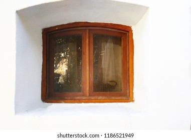 Window outside on a white wall background.