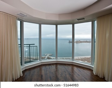 Window overlooking a lake in the city