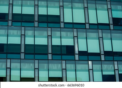 Window Patterns II: Drawn shades create patterns in the tinted windows.