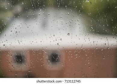 Window raindrops on top of warm background texture
