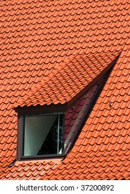 Window in the red tiled roof