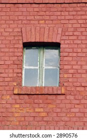 Window and red wall in city.