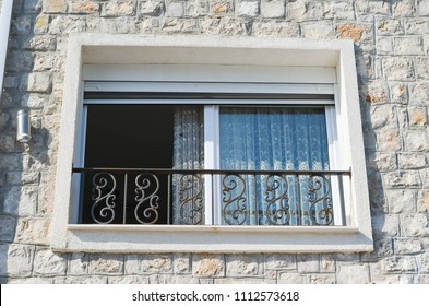 Window with rolling shutters  on the vintage stone house