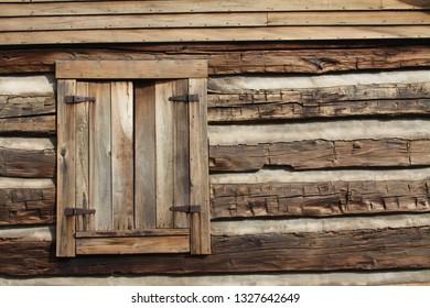Window of a rustic log cabin.