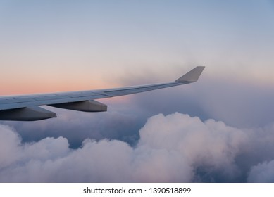 Window seat flying high above the clouds.