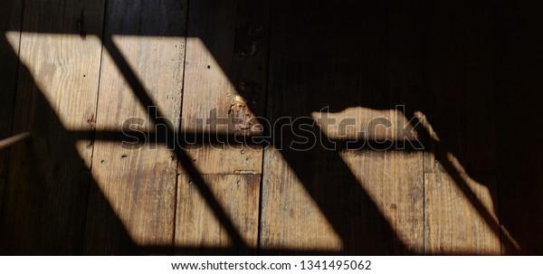 Window shadow in wooden floor.