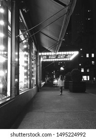 Window shopping New York City NYC 5th Avenue street view empty sidewalk late night lights