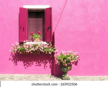 window with shutters in Burano in Italy