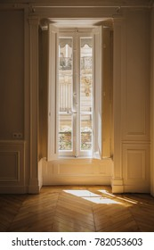 Window and shutters in an classic and stylish empty apartment in Lyon, France.