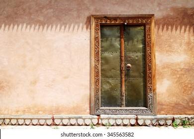 Window with shutters in decorated wall at Chashme Shahi Garden, Srinagar, Jammu & Kashmir, India.