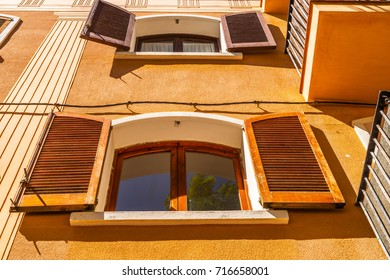 window shutters on an old european style building, architectural decoration old windows, vintage style, a protective element of windows, interesting detail