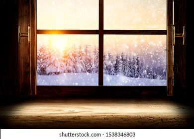 Window sill of free space for your decoration and Christmas landscape of trees and sunset .