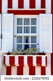 Window of striped houses in Costa nova, Aveiro, Portugal