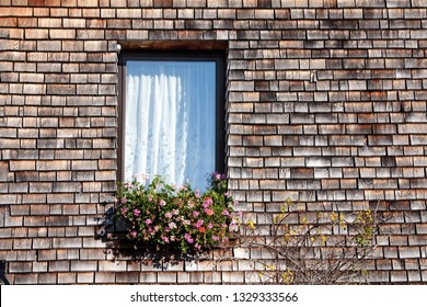 Window with traditional Shingle wall - an European traditional house building style, using small pieces of woods for wall facade