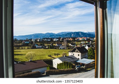 Window view to Austrian Alps from the hotel in the Austrian village