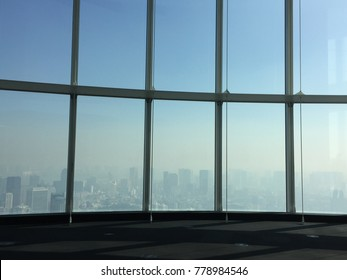 Window view blue sky background on high building in Tokyo, japan