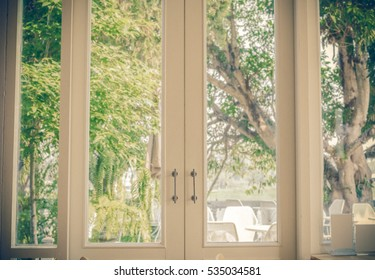 Window with a view of the garden and vintage tone