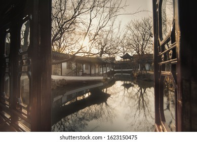 The window view at Humble Administrator Garden(Zhuozheng Garden) in early morning.Zhuozheng Garden a classical garden,in UNESCO World Heritage Site and is the most famous of the gardens of Suzhou.