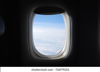 Window View From Passenger Seat On Commercial Airplane