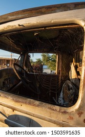 window view of rusty antique abandoned truck