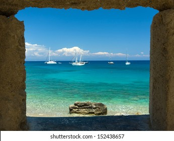 Window view at sea and yachts. Rhodes Island, Greece.