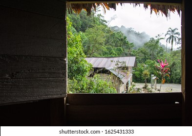 Window view from a traditional wooden cottage on a romatic jungle village near Banjos, Ecuador