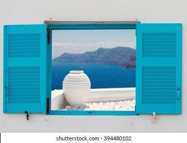 window with view of  white greek amfora against volcano caldera,  Santorini island, Greece
