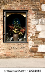Window in vintage 19th Century brick and rubble building.