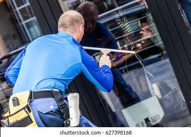 window washer working  wash glass on building