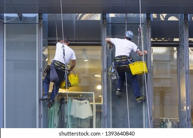Window washers cleaning the windows of shopping center